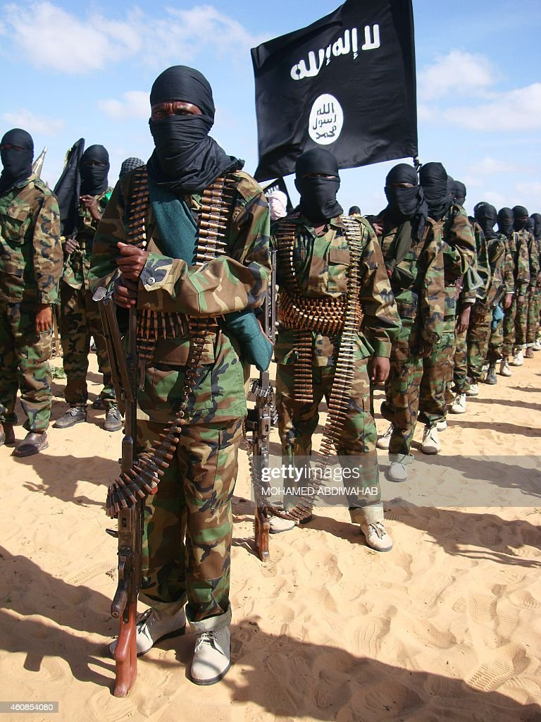 Somali AlShebab fighters gather on February 13 2012 in Elasha Biyaha in the Afgoei Corridor after a demonstration to support the merger of Alshebab...