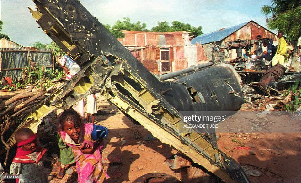 Somali children play 09 December 1993 around the wreckage of a US helicopter shot down last October when US forces fought with Somali gunmen US...