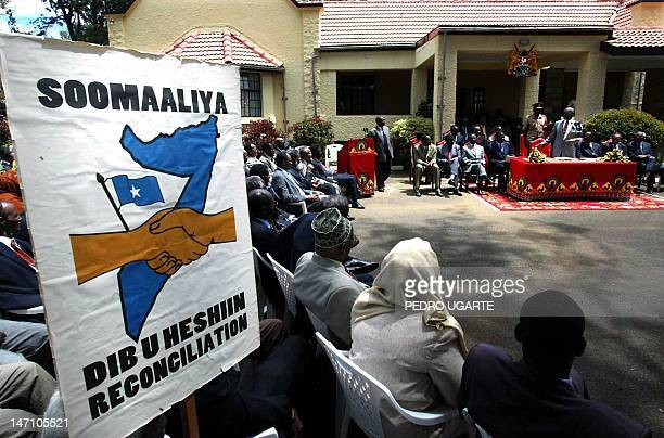 Somali delegates listen to Kenyan president Daniel arap Moi's speech in Eldoret 31 October 2002 after the ceremony in which president Moi endorsed a...