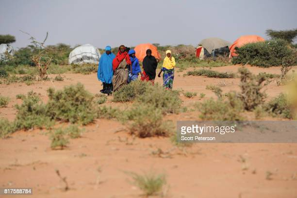 Somali families displaced by severe drought gather at a makeshift camp as the Horn of Africa faces severe drought on the outskirts of Burco Somalia...