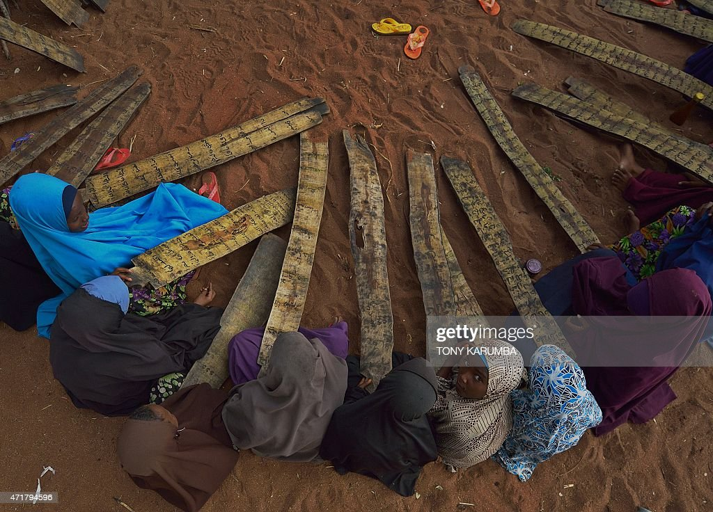 Somali girls attend morning madrassa or Islamic school at Hagadera sector of the Dadaab refugee camp north of the Kenyan capital Nairobi on April 29...