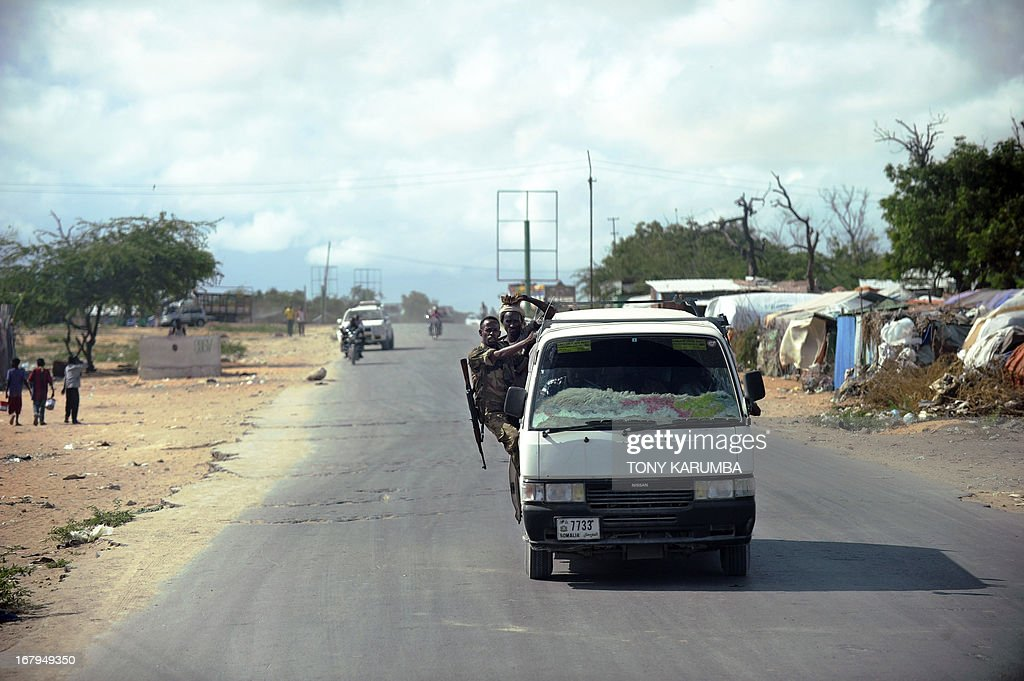 Somali government soldier with his rifle slung over his ...