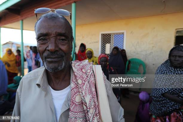 Somali herder and chief of camp Hussein Abdi stands for a portrait as families displaced by severe drought gather and squat at government housing...