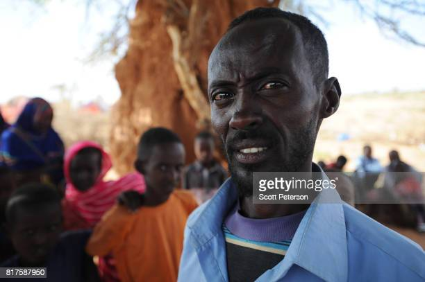 Somali herder Osman Ismail stands for a portrait as families displaced by severe drought gather at a makeshift camp as the Horn of Africa faces...