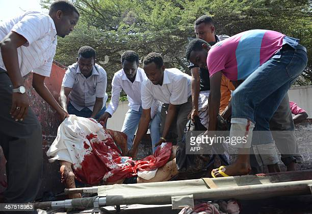 Somali hospital staff at the Medina hospital in Mogadishu receive the body of one of the three Syrian doctors killed on December 18 2013 some 30 km...