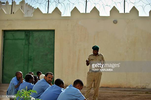 Somali inmates attend a rollcall performed by a security warden in the courtyard of the UNfunded prison in Hargeisa the capital of Somalia's...