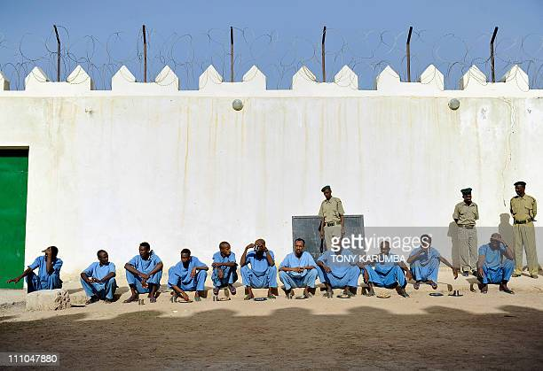 Somali inmates take their breakfast in the courtyard on March 29 2011 at the UNfunded prison in Hargeisa the capital of Somalia's selfdeclared state...