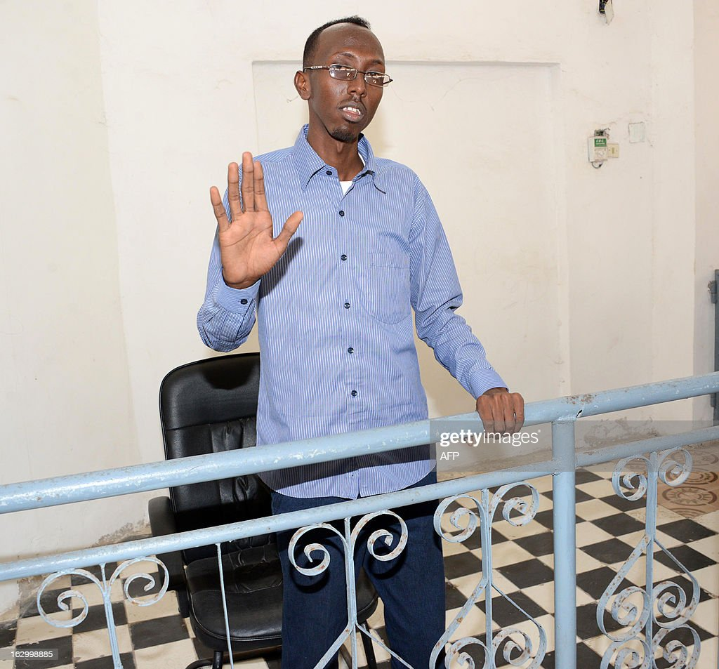 Somali journalist Abdiaziz Abdinuur, 25, gestures at the court house in Mogadishu on March 3, 2013. A Somali appeals court dropped charges today against a woman sentenced to a year in jail after she told a reporter she was raped by security forces, but said the journalist will remain in jail for six months. Last month the woman and journalist Abdiaziz Abdinuur, 25, were found guilty of offending state institutions and sentenced to a year in jail. Abdinuur -- who was detained on January 10 while researching sexual violence in Somalia, but did not air or print any report after interviewing the woman -- was also found guilty of 'making a false interview, and entering the house of a woman whose husband was not present.' AFP PHOTO / Mohamed Abdiwahab