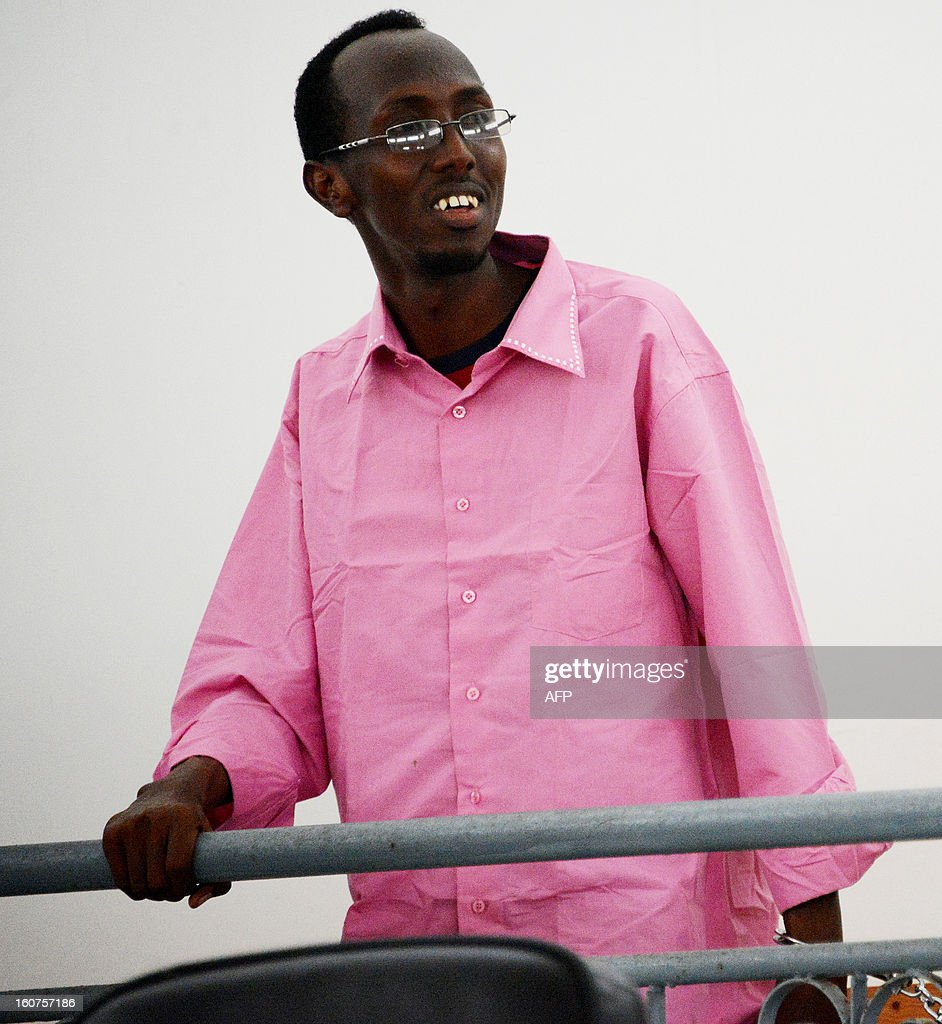 Somali journalist Abdiaziz Abdinuur Ibrahim is pictured in court in Mogadishu on February 5, 2013. A Somali court has sentenced a woman who said she was raped by security forces and journalist Abdinuur, who interviewed her, saying they were guilty of insulting the state. Abdinuur, who works for several Somali radio stations as well as international media, was detained on January 10, 2013 after researching rampant sexual violence in Somalia. Human rights groups have condemned the ruling against the rape victim and Abdinuur. AFP PHOTO/Mohamed Abdiwahab