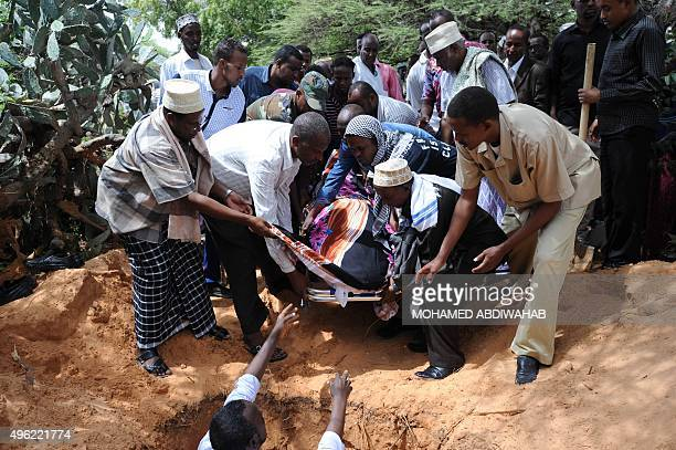Somali lawmakers and relatives bury the body of slain MP Mohamed Ahmed Gurhan during his funeral in Mogadishu on November 8 2015 Gurhan was gunned...