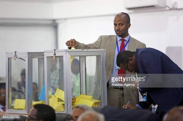 Somali lawmakers cast their ballot to elect the countrys next president at the parliament in Mogadishu Somalia on February 08 2017 Members of the...