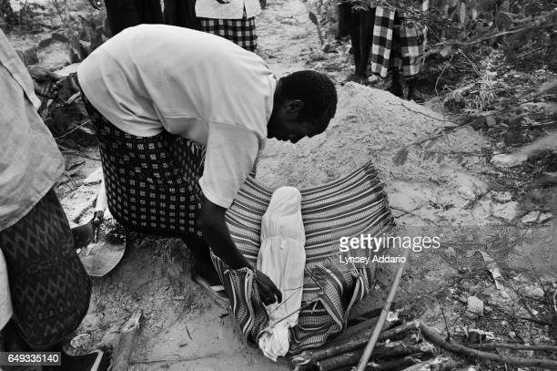 A Somali man buries a child at a camp for internally displaced people in Mogadishu Somalia on Aug 28 2011