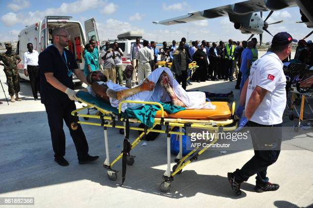 Somali man severely wounded during last suicide attack in Mogadishu is transported on a stretcher to board a Turkish military plane on October 16...