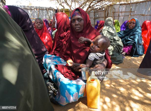 Somali mother and her child at a World Food Program humanitarian aid registration center in Mogadishu According to an United Nations February 2017...