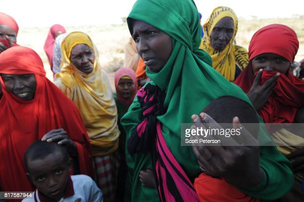 Somali mother Basra Yusuf speaks as families displaced by severe drought gather at a makeshift camp as the Horn of Africa faces severe drought on the...