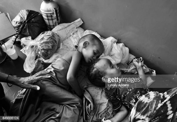 Somali mothers tend to their children who are being treated for diarrhea and severe malnutrition at Banadir Hospital in Mogadishu Somalia on Aug 29...