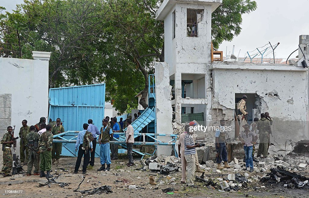 Somali National Government (SNG) soldiers and police are pictured at the scene after Al-Qaeda linked Shebab insurgents shot and blasted their way into the United Nations (UN) compound in Mogadishu on June 19, 2013. It is the most serious attack on the UN in the troubled country in recent years. Three foreigners and at least two Somali security guards were killed during an attack by Islamist insurgents on a United Nations compound in Mogadishu UN sources were quoted as saying. AFP PHOTO/MOHAMED ABDIWAHAB