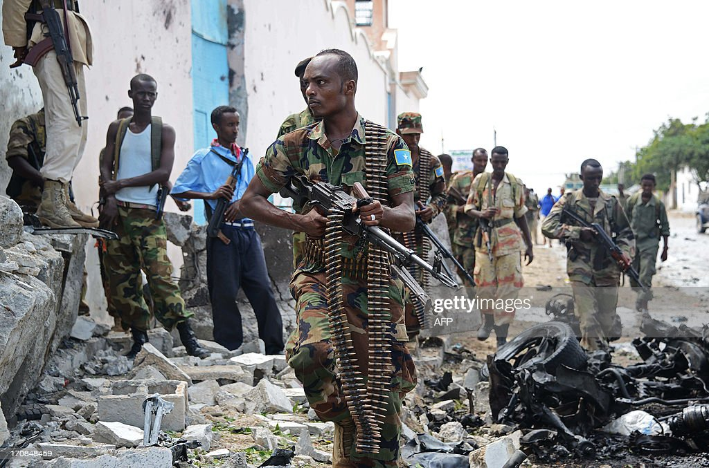 Somali National Government (SNG) soldiers are pictured after Al-Qaeda linked Shebab insurgents shot and blasted their way into the United Nations (UN) compound in Mogadishu on June 19, 2013. It is the most serious attack on the UN in the troubled country in recent years. Three foreigners and at least two Somali security guards were killed during an attack by Islamist insurgents on a United Nations compound in Mogadishu UN sources were quoted as saying.