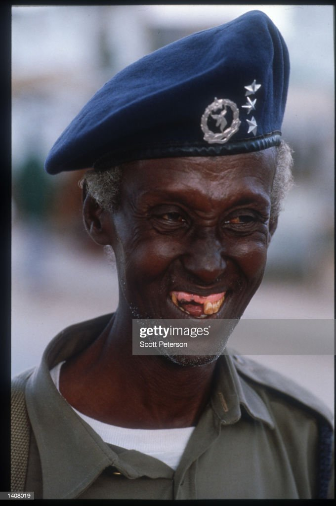 Somali police officer smiles May 4 1993 in Mogadishu Somalia Following the departure of the US forces UN troops continue the humanitarian...