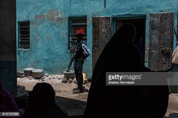 Somali police officer watches over a market on October 11 2016 in Barawe Somalia Barawe was a stronghold for the AlShabaab militant group in...