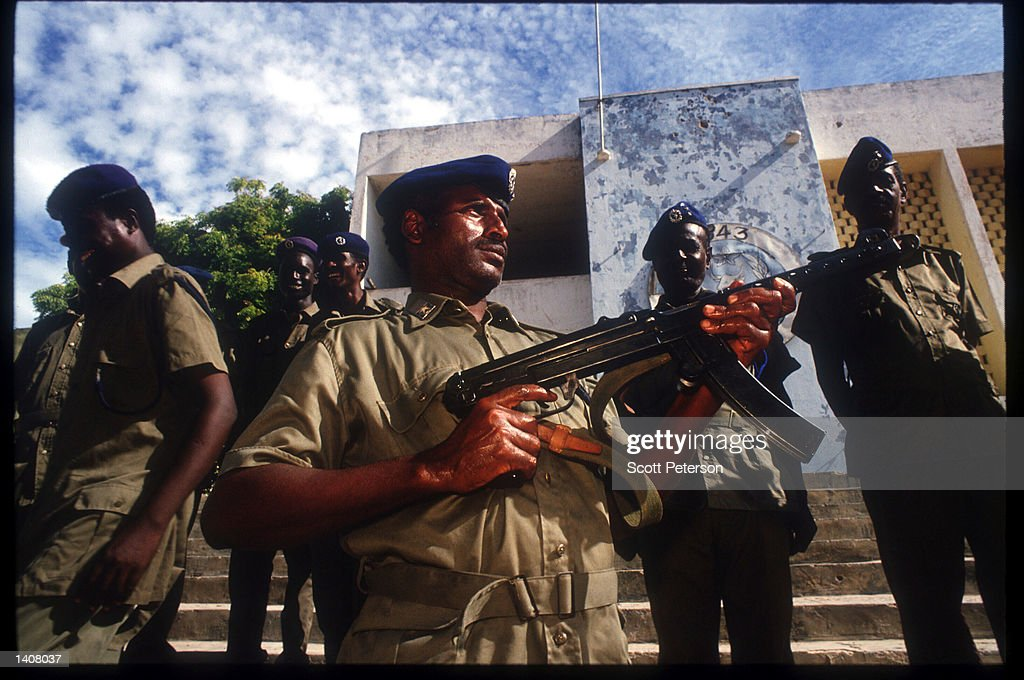 Somali police officers pose May 4 1993 in Mogadishu Somalia Following the departure of US forces UN troops continue the humanitarian intervention...