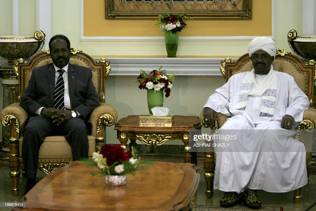 Somali President Hassan Sheik Mahmud (L) meets with Sudanese President Omar al-Bashir at the presidential palace in Khartoum, on January 2, 2013.