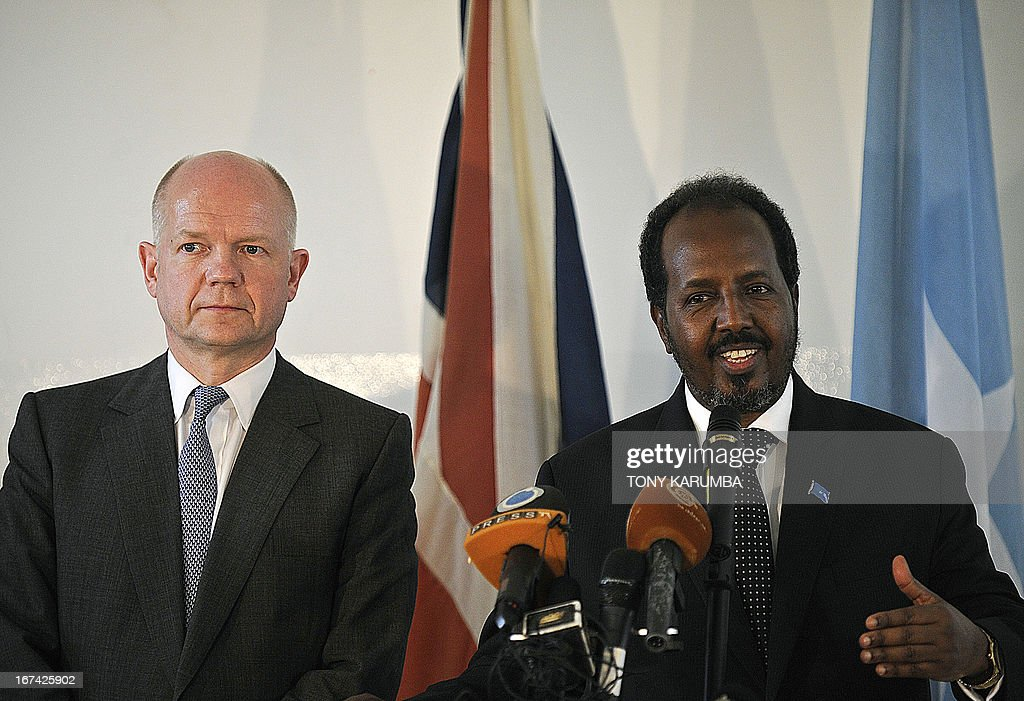 Somali President Hassan Sheik Mohamud (R), with British Foreign Secretary William Hague, speaks during a press conference on April 25, 2013following the re-opening of the British Embassy in Mogadishu. Hague inaugurated the embassy in Mogadishu, 22 years after London pulled its diplomats from conflict-torn Somalia. AFP PHOTO /TONY KARUMBA