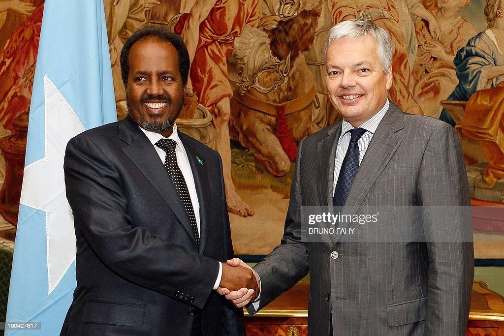 Somali President Hassan Sheikh Mohamud (L) and Belgian Foreign Minister Didier Reynders shake hands on January 31, 2013 before their meeting at Egmont Palace in Brussels. Somalia's new leader secured promises of an economic and political 'New Deal' on January 30 during his first European Union visit, days after the nation's government formally won US recognition. AFP PHOTO / BELGA / BRUNO FAHY - BELGIUM OUT -