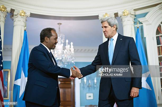 Somali President Hassan Sheikh Mohamud shakes hands with US Secretary of State John Kerry prior to talks at the State Department in WashingtonDC on...