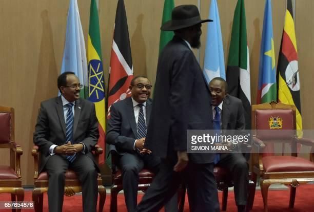 Somali President Mohamed Abdullahi Mohamed Ethiopian Prime Minister Hailemariam Desalegn and Kenya's President Uhuru Kenyatta look at South Sudan...
