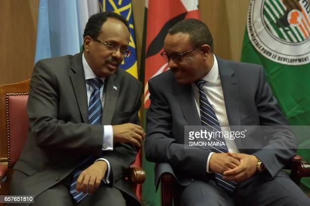 Somali President Mohamed Abdullahi Mohamed speaks with Ethiopian Prime Minister Hailemariam Desalegn during the East Africa's regional...