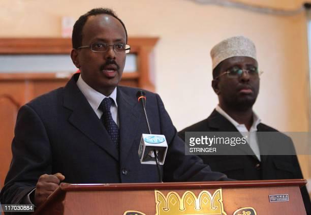 Somali Prime Minister Mohamed Abdullahi Mohamed speaks during a press conference as Somali president Sarif Sheik Ahmed looks on at the presidential...