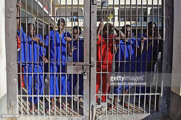 Somali prisoners convicted of piracy stand behind a gate of the prison in Garowe Puntland state in northeastern Somalia on December 14 2016 The...