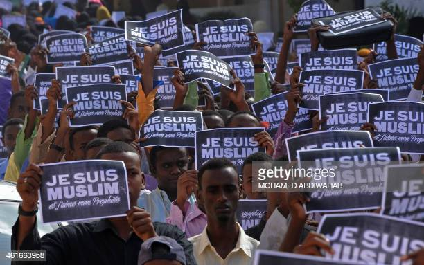 Somali protesters chant slogans holding placards reading 'I am a Muslim and I love my prophet' on January 17 2015 in Mogadishu to protest against...