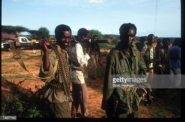 Somali rebels pose for a photograph June 15 1992 in Kismayo Somalia 'Col' Ahmed Omar Jess and his rebels move freely inside the Ethiopian Ogaden...