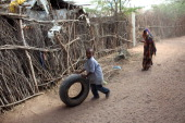 Somali refugee boy plays with a car tyre in the IFO refugee camp which makes up part of the giant Dadaab refugee settlement on July 24 2011 in Dadaab...