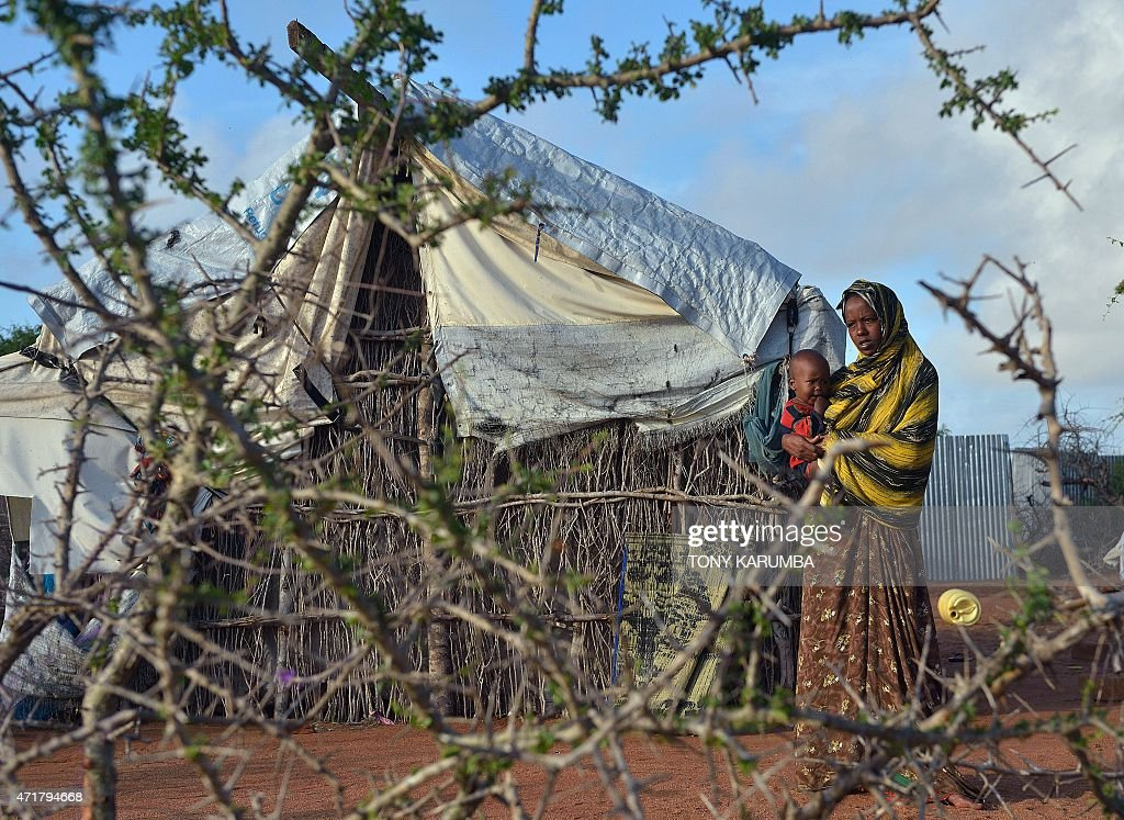 A somali refugee woman with her child stand in their compound at Hagadera sector of the Dadaab refugee camp north of the Kenyan capital Nairobi on...