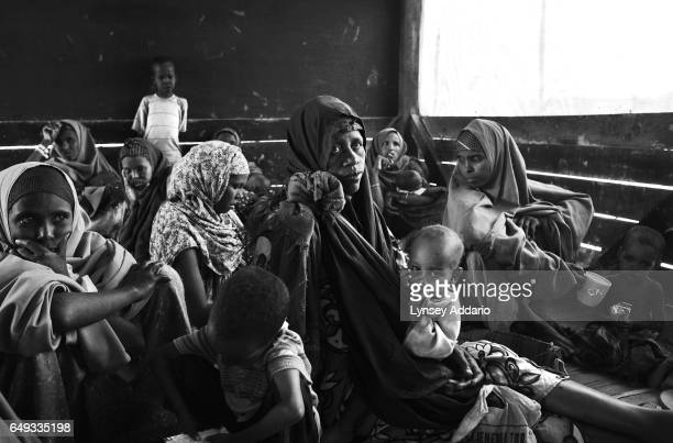 Somali refugees are seen during a nutrition check at a health post within the Dadaab refugee camp at the Kenyan border with Somalia on Aug 20 2011