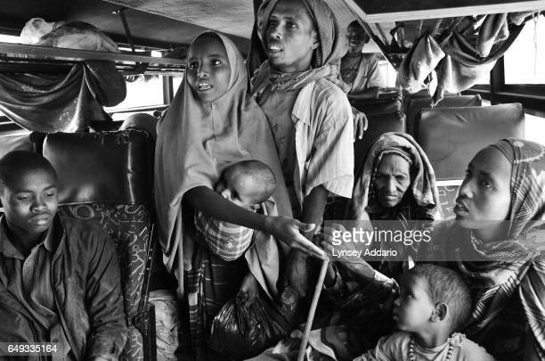 Somali refugee's are seen on a bus on their way to the border town of Liboi about 35 miles from the Dadaab refugee camp where they will be greeted by...