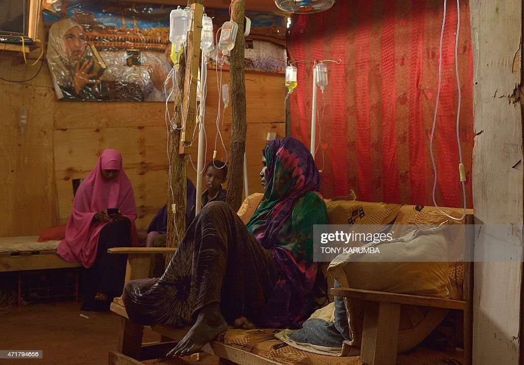 Somali refugees are treated at a private clinic within IFO main camp in the sprawling Dadaab refugee camp north of the Kenyan capital Nairobi on...
