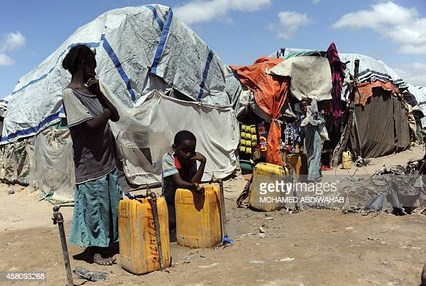 Somali refugees go about their daily lives on October 30 2014 in the at Sayyid camp south of Mogadishu UN chief Ban Kimoon warned on October 30 that...