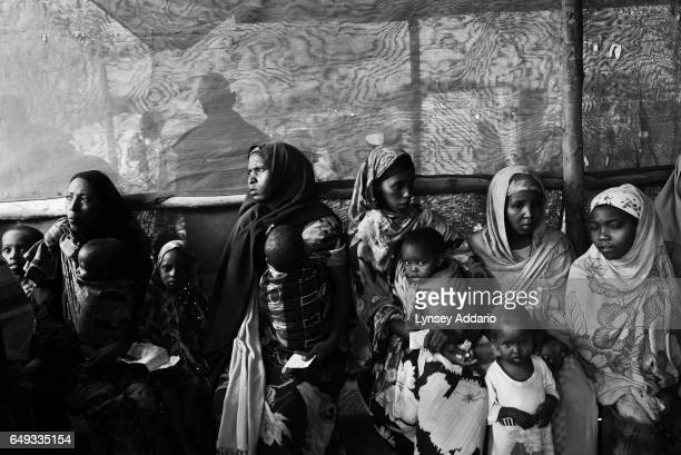 Somali refugees seek shelter in the Dadaab refugee camp after fleeing a prolonged drought near the Kenyan border with Somalia on Aug 20 2011