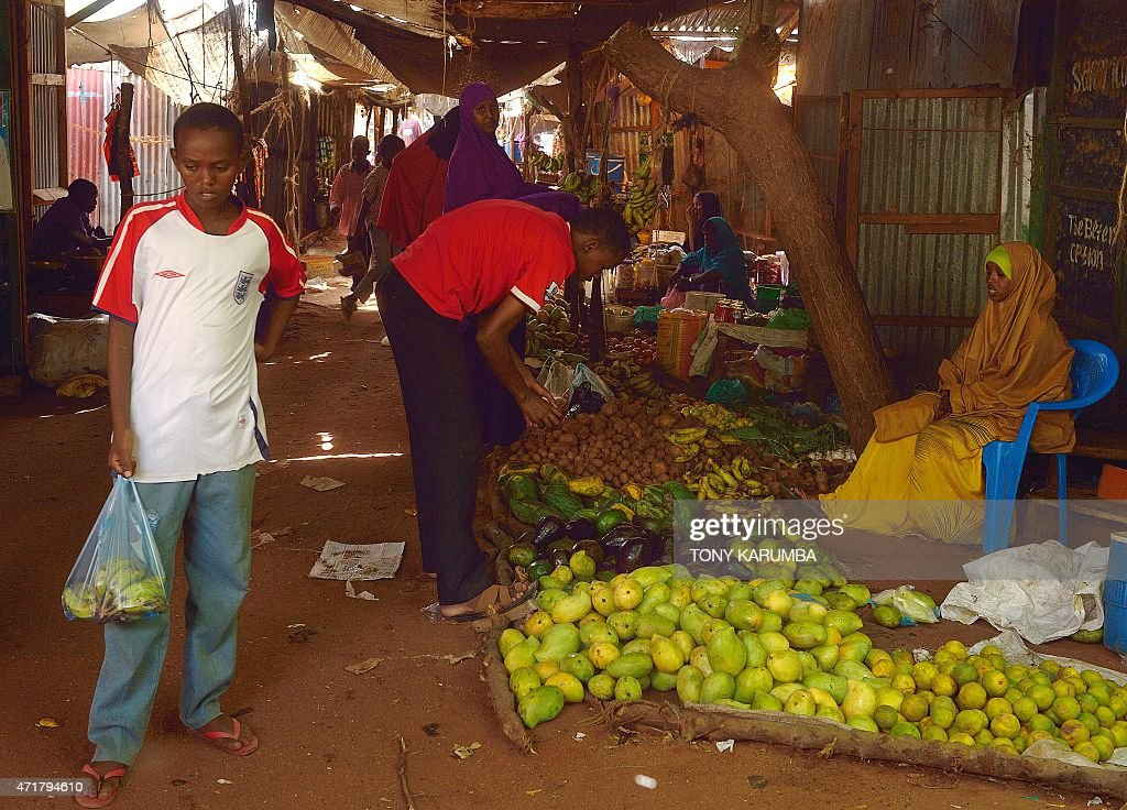 Somali refugees shop for fresh produce at a market within Hagadera camp in the sprawling Dadaab refugee camp north of the Kenyan capital Nairobi on...
