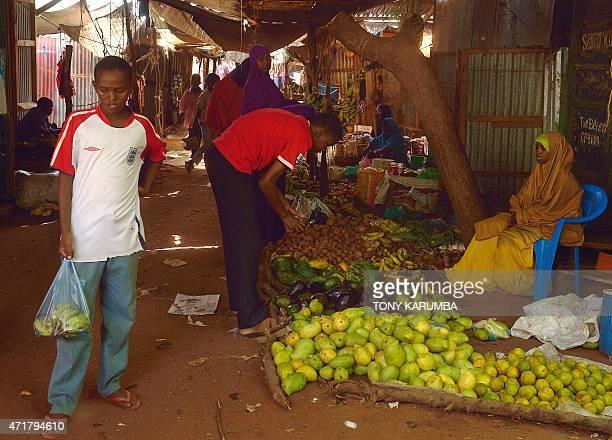 Somali refugees shop for fresh produce at a market within Hagadera camp in the sprawling Dadaab refugee camp north of the Kenyan capital Nairobi on...