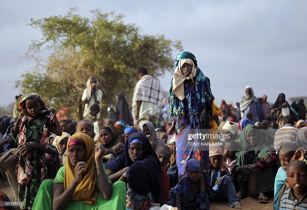 Somali refugees wait at dawn at a registration centre on August 2 2011 at Dagahaley refugee site within the Dadaab complex to be registered to...