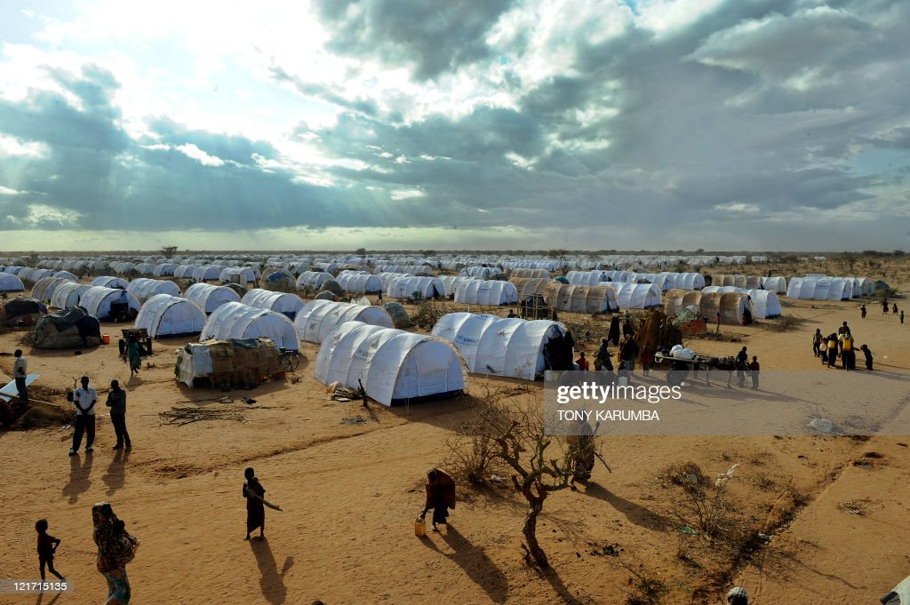 Somali refugees walk at the new Ifoextension in Dadaab on July 31 2011 The new site opened to some 5000 refugees among an ever swelling number of...
