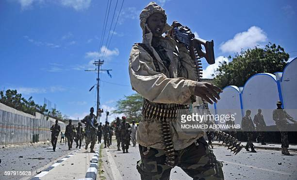 TOPSHOT Somali security forces patrol the scene of a suicide car bomb blast on August 30 2016 in Mogadishu At least seven people were killed on...