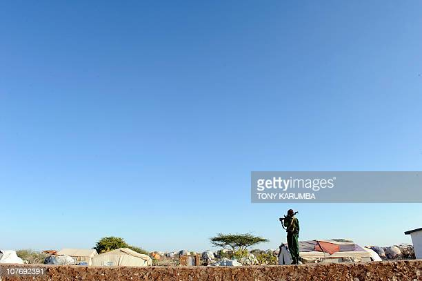 Somali soldier guards on December 2 2010 a camp for internally displace people in Galkacyo Somaliland Each year tens of thousands of Ethiopians and...