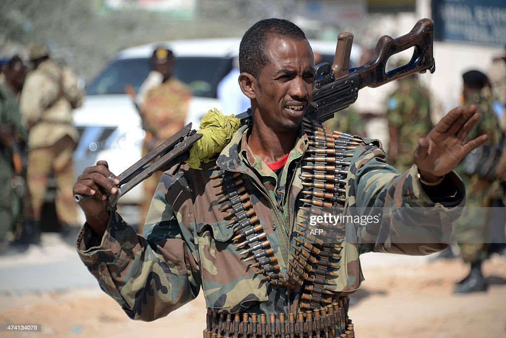 Somali soldiers patrol the streets of Mogadishu on February 22 2014 a day after nine AlShabab insurgents wearing military fatigues and carrying guns...