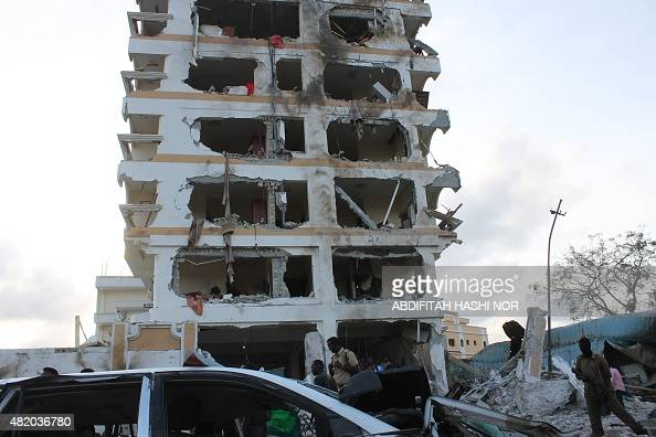 Somali soldiers stand in front of the damaged Jazeera Palace hotel following a suicide attack in Mogadishu on July 26 2015 Somalia's Shebab...